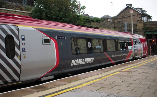 "In 2010 Virgin West Coast set 221 144 ""Prince Madoc"" was named ""Bombardier Voyager"", a name applied to non-tilting Voyager 220 017 before 2007, although in 2011 a decision was made to disband 221 144.  This allowed Driving Motor Standard 60394 and Driving Motor First 60494 to become spares - with the ability to form a power twin 2 car set - and the Motor Standard Restaurant  Buffet and  Motor Standard vehicles to be respectively added to remaining Virgin West Coast four-car sets 221 142 and 221 143."