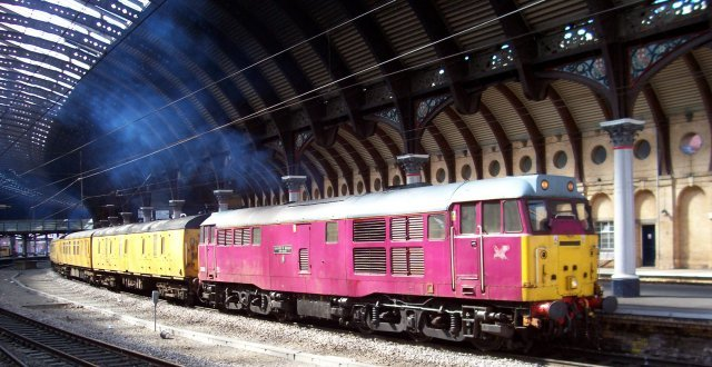 "A welcome throwback to ""the good old days"" of York station was the arrival of a Network Rail test train composed of yellow Mark1 and Mark 2 carriages, led by 31 601""Gauge O Guild 1956-2006"" in the cerise pink usually associated with DMUs on the Heart of Wales line. The former 31 186 is currently owned by ECT Mainline Rail and is based at Barrow Hill Depot, Chesterfield. Also throwing out blue smoke from its English Electric 12SVT prime mover into the vaulted roof of Thomas Prosser's curved train shed was 31 190 - originally D5613 and much more conservatively dressed in the one time class standard of Brunswick Green with white horizontal bands. The Derby based A1A-A1A is part of Rail Vehicle Engineering."