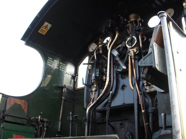 "As well as taking the opportunity to re-acquaint myself with the number, name and worksplate,  the separation of the Great Western Railway 4-4-0 from its tender allowed some uncommon views of the footplate. Particularly noticeable were the now-mandatory overhead electrification warning sign on the underside of the cab roof and the painted data on the left hand side.  As well as the TOPS identity of 98240 alongside the more familiar 3440, the 2000th locomotive to be outshopped from Swindon Works is also now limited to 60 mph or 35 mph running tender first - a far cry from  9 May 1904 when the then 13 month old  ""City"" class locomotive became, according to Charles Rous-Marten of The Railway Magazine, the first wheeled vehicle to exceed 100 mph."