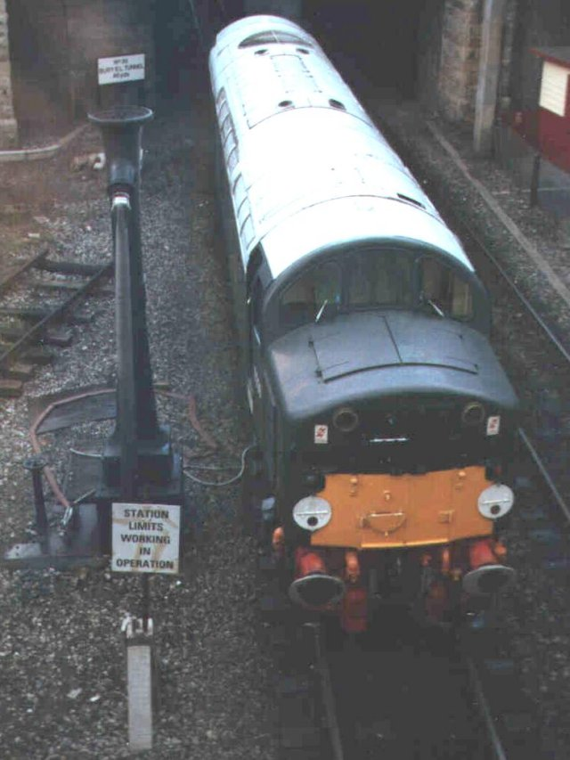A preserved Class 40 ( First numbered in the D200 - D399 series ) with original disc headcode and small yellow warning panel rests at Bury Bolton Street station on the East Lancashire Railway