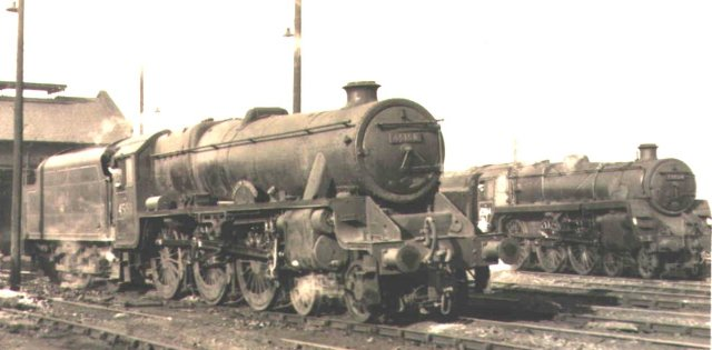 """Black Five"" 4-6-0 45158 ""Glasgow Yeomanry"" rests on shed next to BR Standard Class 5 4-6-0 73064"