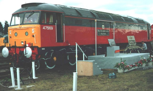 "On 1 July 1990, 47 569 was named ""The Gloucestershire Regiment"" by Brigadier S.D.A. Firth OBE at Gloucester Horton Road Open Day after a repaint in red and dark grey Parcels livery."