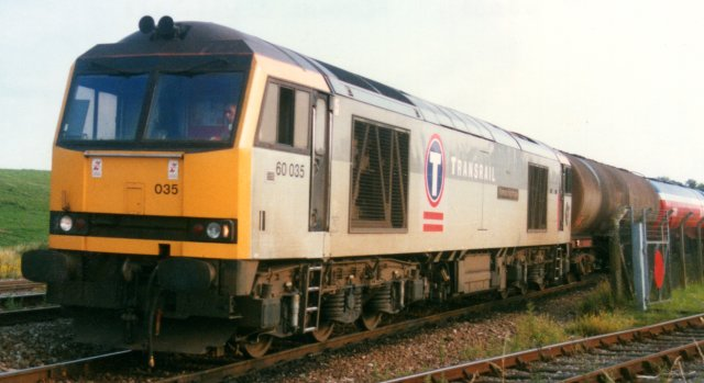 "The original multiple unit working equipment cover was also replaced with a new hinged type and driver's two-position side windows replaced by three section varieties.  All thee of these modifications can be seen in the picture above of 60 035 ""Florence Nightingale"" at Westerleigh on 22 July 1997."