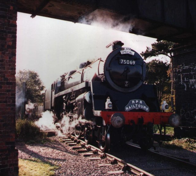 British Standard 4MT 75069 leaves Bulmers Steam Centre at Hereford ready to power a Welsh Marches Express working of the early 1990s. Click on picture for more on British Standard Steam