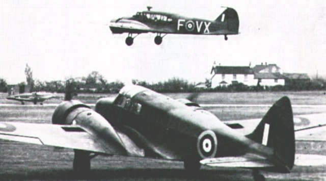 Skyfame's Airspeed Oxford -V3388 - waits for its museum companion - Avro Anson - coded FVX - to land at Staverton. Note too the Hunting Jet Provost taxiing toward the Oxford's port engine.