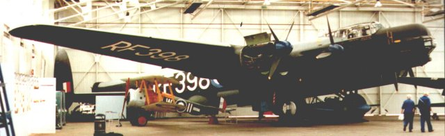 The Avro Lincoln - seen here at RAF Cosford - dwarfed the Lancaster it was derived from. Although 30 years younger than the biplane parked under its wing, it was soon to be made obsolete itself by a new generation of jet propelled V bombers.  The nacelle nearest the camera is open to reveal its Rolls Royce Merlin engine.