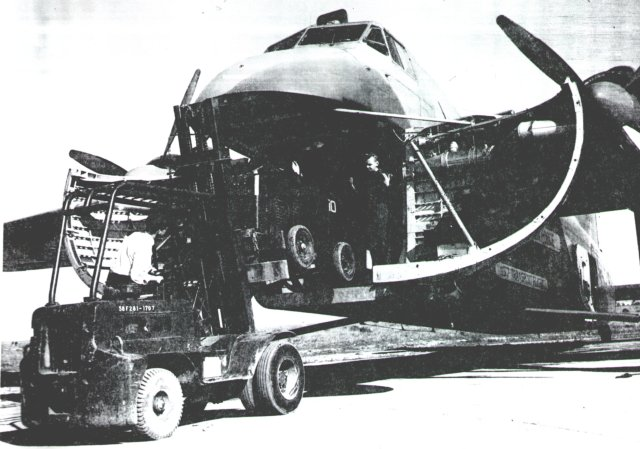 One fork lift loads another aboard a Royal Canadian Air Force Mark 31M. One advantage of the Bristol Type 170 design was the small vertical distance of the floor from the ground