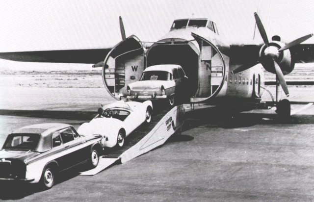 "Silver City Airway's Bristol 170 Mk 32 Superfreighter G-ANWN takes on its full compliment of three cars. Note the modified clamshell doors, now the full height of the nose compared to earlier variants. G-ANWN was named ""City of Hull"" in 1959 and was transferred to Cie Air Transport as F-BPIN on 2 January 1968. However, her last flight was back to Lydd for scrapping on 4 April 1969."