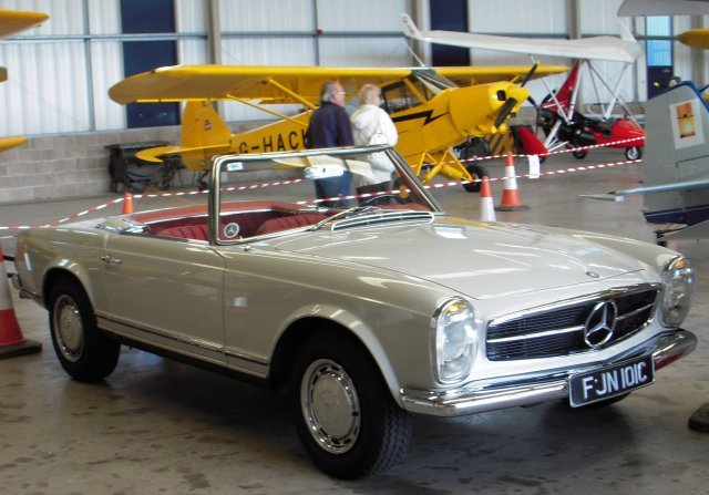 Also on display in the hangar courtesy of Manuel Queiroz were a 2308 cc beige 1964 Mercedes 230SL (above) and a 1971 Fiat 500 (below)  Left hand drive leather upholstered Mercedes FJN 101C was produced early in the 1963-1967 production run while right hand drive Fiat CTO 972K was outshopped in yellow with a black trim from Turin towards the end of manufacture from 1957 to 1977.  It can also be identified as an L model by the chrome nudge bar.