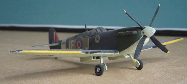 "The Spitfire Mark IX entered service with 64 Squadron in July 1941 with 64 Squadron RAF and the Jet Age Reserve Model Collection is proud to own two examples - one ""wheels up"" and the other with undercarriage deployed - of this particular Mark IX ,serial EN 398, the personal mount of the British flying ace with the most ""kills"" during the World War II.  Air Vice Marshal James Edgar ""Johnnie"" Johnson CB, CBE, DSO and two Bars, DFC and Bar (9 March 1915 - 30 January 2001) accounted for 38 Luftwaffe machines and flew EN 398 with his personalised JE- J markings as Officer Commanding the Kenley Wing of Fighter Command in 1943."