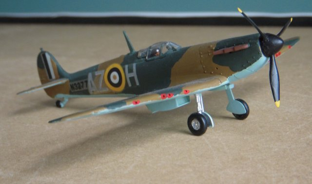 "As well as being familar to generations of boys as ""the Airfix Spitfire"", N3277 - issued to 234 Squadron RAF as AZ - H - had the unusual distinction of flying with both the Royal Air Force and the Luftwaffe.  On 18 August 1940 N3277 was flown by Pilot Oficer Richard Hardy from 234 Squadron's base at Middle Wallop in Hampshire ( later home of the Army Air Corps ) and at 1830 engaged in combat with a Messerschmitt Bf 109 near Swanage but was later forced to land on a beach near Cherbourg.  Hardy became a prisoner of war but N3277 - captured almost intact - was flying again a few weeks later with a Mercedes-Benz DB601 engine and the numbers 5 and 2 either side of a Luftwaffe cross on each side of the fuselage."