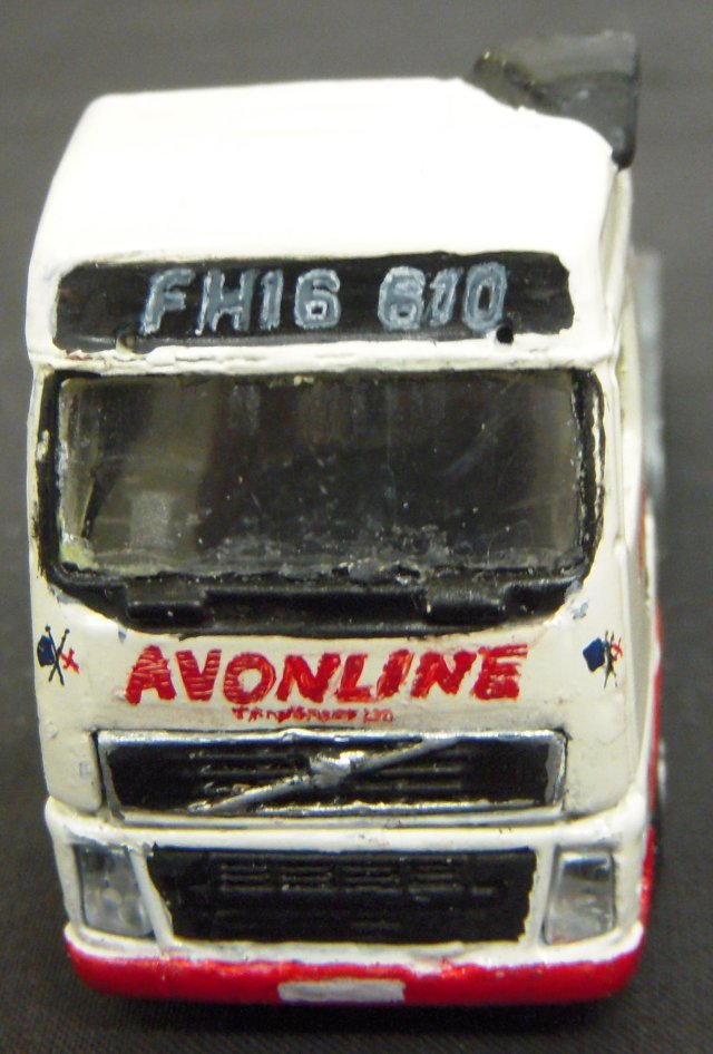 Between the St George and Union flags, the red legend of Avonline Transport Ltd of Corse Lawn was in real life built up of horizontal lines but was re-created by Paul scoring a knife through more conventional paintwork.  At one point in the first decade of the 21st Century, the Volvo FH16 610 was the most powerful lorry tractor unit in Britain with a power output almost twice that of a BR Class 08 diesel shunter although with a fuel consumption of only 7.8 miles per gallon of DERV!