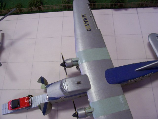 The idea of combining  N gauge trains with 1/144 scale aircraft first came to me at the Autumn 2006 Cheltenham GWR Modeller's Exhibition when the only way to display a 1/72 scale Bristol Type 170 Mark 32 Superfreighter on my Airfield Diorama was to remove the toddler-resistant perspex from the front and let one wing spill out of the scenic area.  As a result, the least unrealistic picture I could take from above meant putting the Superfreighter's tail against the side of the box, the starboard wingtip just clear of the fence by the railway and cropping the port wing just beyond the engine nacelle.