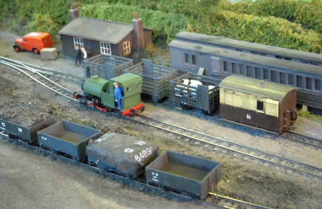 "Llanfairish was originally conceived as an 009 test track but has since developed a life of its own - based on the goods only era of the 1940s and 50s at Llanfair Caereinion on the 2'6"" gauge Welshpool and Llanfair Railway in mid Wales."