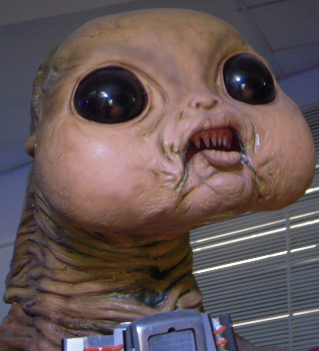 "Calling this feature Aliens of Coventry was partly an homage to the first two-part story of the Christopher Eccleston era ""Aliens of London"" in which criminal members of the Slitheen family of Raxacoricofallapatorius ( pictured below ) trick the World's scientists into gathering in Britain's capital by first crashing a spacecraft through the Clock Tower of the Palace of Westminster. Although many special effects in the 21st century Doctor Who are computer generated, this one required a large scale model of just one face of the clock that makes Big Ben bong.   Had this been real life, perhaps the ruined tower could have been replaced by a multi story duck house with quacks instead of Westminster chimes, but as it is Doctor Who - which is mainly created in and around Cardiff - has offered international viewers a range of British locations apart from the cliched views of London so beloved of Hollywood film makers."