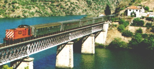 An unidentified member of CP Class 1400 crosses the River Douro on a viaduct near Tua