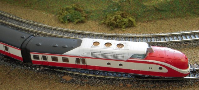"A real seven-vehicle  ""Helvitia"" train set  - owned by Deutsche Bundesbahn and built with aluminium bodies on welded steel chassis - connected Hamburg with Zurich from the 1950s  and was known as Class 601 by 1970.  Powered by a pair of 1 100 MAN prime movers yielding a top speed of 95 mph, each 63' long driving vehicle contained a 250 bhp diesel engine for a 260 volt generator to power the lights, cooking and air-conditioning as well as compartments for railway crew and customs officers."