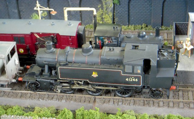 "Aptly enough, the Bromsgrove based group of operators assisting Rob Newman supports The Stanier 8F Locomotive Society in preserving LMS 2-8-0 48773 - while Henry George Ivatt, William Stanier's successor as LMS Chief Mechanical Engineer, designed the Class 2P 2-6-2T 41246 pictured above hauling a typical Midland Railway brake van past ex Lancashire and Yorkshire ""Pug"" 0-4-0ST 51217 and a six wheeled Travelling Post Office."
