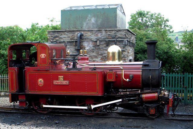 "12 ""Hutchinson"" was also only the second Isle of Man Steam Railway locomotive to be rebuilt with a Hunslet boiler and one of only two engines ( the other being 5 ""Mona"") to carry its brass fleet number above the name plate on the the tank side as opposed to the chimney or cab side - a feature lost prior to its 1981 rebuild but reinstated for 2009 and visible in the picture below taken at Port Erin at the end of the journey."