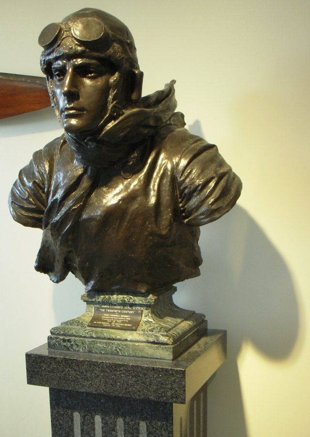 "Nearby was a bust of an early aviator entitled ""The Twentieth Century"" and sculpted by Mary Pownall Bromet (1889 to 1932), exhibited at the Royal Academy in 1928.  It was presented to the Isle of Man Government by Air Vice-Marshal Sir Geoffrey Bromet, the departing Lieutenant Governor, on 7 September 1952."