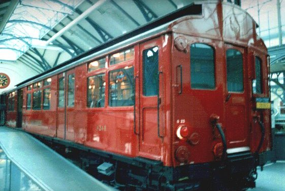 London Transport (LT) ordered underground trains for its District Line ('G' Stock, later uprated to 'Q' standard, as seen below at Acton in this Michael A. Morant collection image) and subsequently bought battery locomotives, cable drum, hopper and flat wagons from The Gloucester Railway Carriage and Wagon Company.