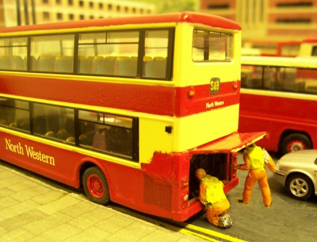 By the sodium street lights, two North Western Road Car technicians investigate a Leyland Olympian that is failing to proceed from Brocklecote Bus Station.