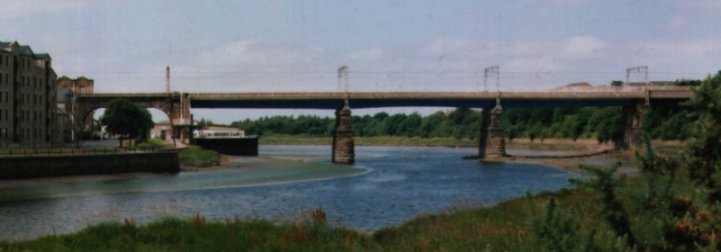 Carlisle Bridge carries the West Coast Main Line over the Lune at Lancaster