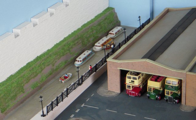 As can be seen from the pictures above and below, the 3' x 2' ex Brentwood diorama offered depot buildings and a yard with a fuel tank as well as a repair shop with inspection pits and an excursion booking office with administration space above.  In short, plenty of room for my own limited coach collection as well as guest vehicles.  But now that I had decided that the only way was York - and more specifically York's fictional Chinatown district - how could the sense of location be achieved?