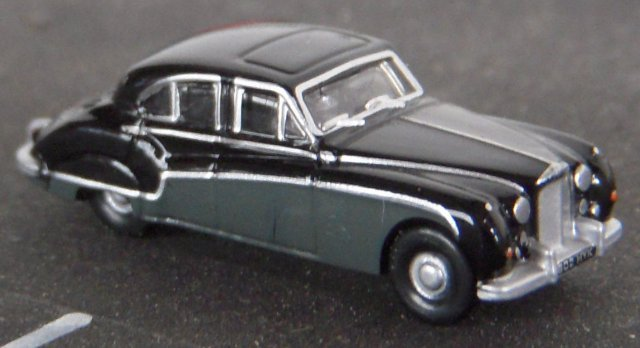 The Jaguar Mk 8 replaced the Jaguar 7M in 1956 and could be distinguished from its predecessor by a new front grille, one piece curved windscreen, cutaway rear wheel spats and larger bumpers.  As well as white wall tyres, a popular optional extra was two tone paintwork, in this case black and Cornish Grey either side of a chrome strip below the waistline.