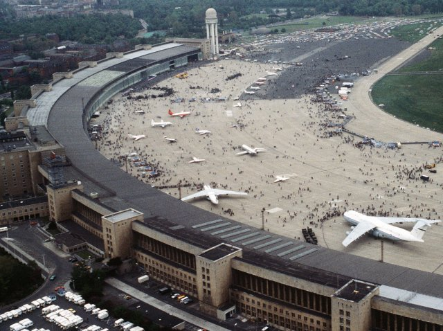 "Although founded in 1923, the main buildings at Berlin Tempelhof airport ( below ) sprang from a 1934 Modernist design by Professor Ernst Sagebiel and combined many of the architectural qualities of Villa Savoye with even more practical features such as an overhanging airside canopy to shelter the ( by modern standards ) small airliners as they unloaded.  This in turn built on the success of Tempelhof in being the World's first airport to have its own underground railway station.  Although built as an overall curve, in Tempelhof - like Villa Savoye - quadrilateral features dominate in what Le Corbusier called ""The Poem of the Right Angle"" - luckily a look that is very easy to replicate in MDF."