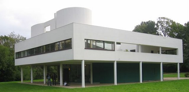 In Modernism form followed function, with the materials and techniques available also defining the finished building.  As early as 1929 one of the great exponents of Modernism - Le Corbusier -  designed the Villa Savoye ( seen above ) to be built from reinforced concrete floors mounted on pillars, which were not disguised even when they went through the fireplace on the upstairs floor.  However, Villa Savoye's construction did allow each floor to be as open plan as necessary with rooms subdivided without the need for the interior walls to bear loads. Similarly the outer walls could form a thin skin to keep the wind and rain out while large horizontal windows offered even illumination.  Le Corbusier even included a roof garden to make up for the amount of green land that Villa Savoye took up.