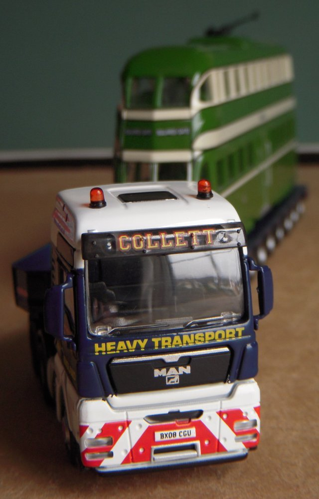 Employees of R. Collett & Sons (Transport) Ltd wear uniforms and are put through the in-house training program which focuses on LGV, Hazchem, Forklift truck and associated specialist operations.  BX 08 CGU, modelled here by Oxford Diecast, is another variation on the MAN TGX XXL 6x4 tractor, this time with an eight axle trailer, and makes an interesting comparison with a similar prime mover - also modelled by Oxford Diecast - in the fleet of Eric Vick of Gloucestershire.