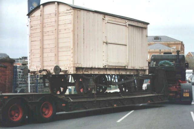 Of these, the cream coloured vehicle pictured above on a low loader turning into Southgate Street, Gloucester, in May 2008 was built in 1940 by Charles Roberts of Wakefield to a North Eastern design.  Purchased to transport ammunition, the all-wooden wagon required repairs to its roof and single leaf sliding doors as well as a repaint on arrival.