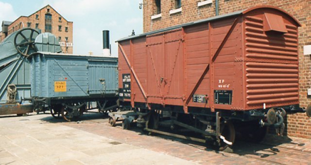 Although RAILSPOT in the Gloucester Journal hit the buffers in late 1992, wagons kept arriving at the National Waterways Museum.   Seen top -  between the Museum's steam dredger and a very well restored  B755715 is blue liveried Royal Navy Armament Depot covered van 321 while fellow Naval wagon 289 is pictured above.  Both arrived from the former Royal Navy Propellant Factory at Caerwent in December 1993 and were believed at the time to be of London & North Western Railway origin due to their rare cupboard type doors.