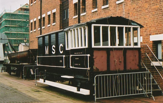 "In November 1996 the National Waterways Museum acquired a 1940s vintage Swindon-built example of the classic Great Western ""TOAD"" brake van.  Unique among the ""Big Four"" railway brake van types in only having one verandah, TOADs were banned from main line use in 1968 but this example was bought for �300 in the 1970s for use as breakdown train stores van on the Manchester Ship Canal railway.  It was taken to the NWM in Gloucester by low loader from Ellesmere Port and was subsequently given a new roof, new windows and anti-rust treatment by Museum volunteers before beginning a new life as an educational resource."