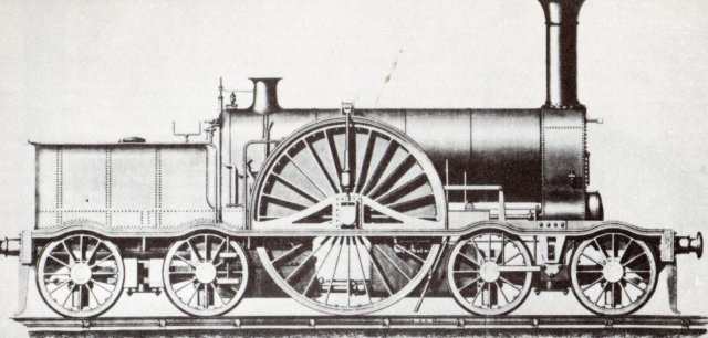 "Despite the feats of speed recorded by the Iron Dukes, locomotive design continued to improve on the Broad Gauge right up to its abandonment in 1892, including this 4-2-4T built by Rothwell of Bolton for the Bristol and Exeter Railway from 1853.  Not only were its 9' diameter driving wheels the largest ever seen on a successful non-geared engine in England but it had true swivelling bogies rather than leading axles fixed to the frame.  A second batch of these locomotives - built before the Bristol and Exeter Railway was absorbed into the Great Western in 1876 - had driving wheels 2"" smaller but still offered more tractive effort than the Iron Dukes despite having the same 18"" x 24"" cylinders."