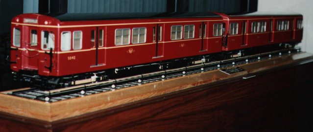 There remains one part of TTC which is forever Gloucester. Two 1/16 scale models – of cars 5042 and 5043 – were commissioned by Sir Leslie Boyce from the famous firm of Basset Lowke and presented to his clients at an inaugural meal on the first day of operations. Today they hold pride of place in the foyer of the Commission's Hillcrest Training Centre offices. The two pictures immediately above were taken by Janet Illingworth-Cooper and the lower one shows Toronto Subway enginner Frank Roberts ( left ) and Toronto transport historian Ray Corley inspecting the 1/16th scale model train.