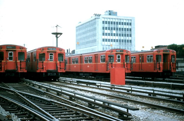 A line-up of G cars at the Davisville Yard with the then-new TTC Head Office building in July 1959: as photographed by the late Gerald H. Landau