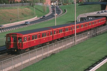 Another excellent view by Robert McMann, taken on 8 May 1985 just outside the Eglinton West Station. What better contrast than spring green grass and the bright red of a Gloucester train!