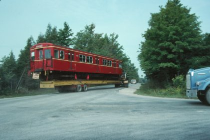 Glen Franks took this view on August 30, 1991, when car 5099 was being delivered to the Halton County Radial Railway Museum. The car was shipped by rail to a nearby siding, and then taken by flatbed to the museum. Car 5098 was delivered a couple of weeks later, by the same method. The Halton County museum has made one of the TTC work cars (which utilized Gloucester controls and equipment as well as trucks - effectively a Gloucester-built flat car with the body supplied by the TTC) operational again and it is carrying on its work duties at the museum.  The TTC had two such cars, and the museum has both of them  preserved.  The two subway cars are apparently to be put into indoor storage when the new storage building is completed.  They look a little worse for wear, but body work has been done on them to keep them from deteriorating and apparently they are operational.