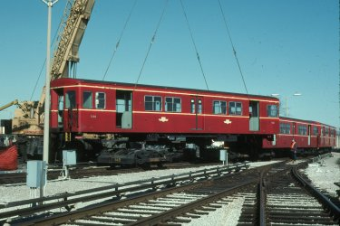Car 5200, first of the G-3 series, is seen being hoisted from its wheels on a sad day in March 1991.