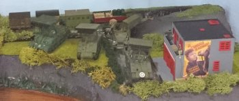 "Perhaps the ultimate development of this first epoch of solid fuel rocketry is the Sherman T34 Calliope tank, seen in the video clip below and depicted in triplicate within my first diorama box. With a Waco Hadrian glider flying in overhead, the 1943 vintage Calliopes stand on the banks of a tributary of the River Rhine at a French colliery ready to bring their 4 1/2"" M8 rockets to bear on opposing German positions during Operation Varsity in 1945. These models are from the Airfix kit (first moulded by Esci) which incorrectly identifies its outcome as being from the US Army's 752nd Tank Battalion which served in Italy as opposed to the 753rd which did in fact invade Germany."
