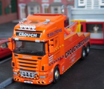 I bought Oxford Diecast's model of a Scania Topline breakdown truck in Crouch Recovery (76SCA02REC) markings as a joke against myself as my knees are not as powerful as they used to be when I need to stand up off the floor, but the orange livery designed for the firm by Kevin Reegan of Burton on Trent and the distinctive registration M40 TOW adds a splash of colour to any diorama as well as being a welcome sight to any stranded trucker.