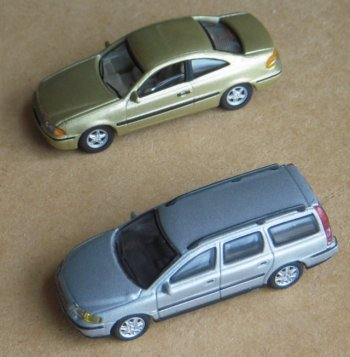 "New vehicles acquired for Ming Ing's 2014 appearance at the Gloucester Model Railway Exhibition included a gold Volvo C70 and silver Volvo V70 from the Cararama range. The C70 is one of the original coupes from the model years 1997 to 2002 although the C70 later evolved into both a soft and hard top convertible. The exterior was designed by the legendary Alnwick-born Peter D. Horbury while the interior design team was led by Mexican Jose Diaz de la Vega. The C70 broke Volvo's decades-long boxy styling tradition, with Peter Horbury - Volvo's design chief from 1991 to 2002 - commenting that the company threw away the box but ""kept the toy inside!"""