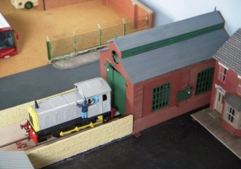 As discussed elsewhere on this website, the five decade old design of the vehicle doors of the Dapol Engine Shed do not reach all the way to modern shallow track and to help minimise the visual impact of this on the diorama some vehicles were needed to cover the gap. In time these could be any historic locomotive or wagon from the National Railway Museum (which could still use the Ming Ing facility for repairs or just the remaining branch of the DVLR for testing) but as a default vehicle I used the Dapol C60 Drewry shunter: not just because it was available but because an ex British Rail example -D2298 - really did work on the Derwent Valley Light Railway.