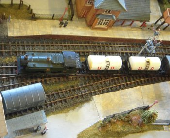 This fictitious 1950s layout was based on the concept that the Midland & South Western Junction Railway continued as a secondary route through the Cotswolds despite the Great Western Railways endeavours to rationalise it during previous years. Trains of former LMS and GWR stock could thus be seen on the 11'6″ long by 20″ scenic section between fiddle yards.