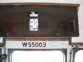 Gloucester's Class 100 and Derby's Class 108 both featured triple windscreens with a destination box above and a two digit headcode display below the central pane of glass. There were also marker lights placed on either side of the headcode display, but on the Derby built unit all the windscreen panels were identical. Rectangular with tightly curved corners, they sloped back so that the line that they formed at the top was parallel to the straight roofline.