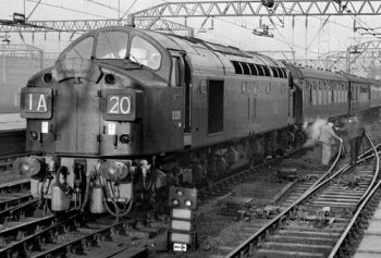 "D306 is also an interesting locomotive in its own right, being one of 20 English Electric Type 4s with 1Co-Co1 bogies assembled at the former Robert Stephenson & Hawthorn factory in Darlington to allow space in the Vulcan Works for the 22 production Deltics to be built. After a brief repaint in BR Blue in 1978, the then 40 106 was outshopped from Crewe in her original Brunswick Green but with full yellow ends. In this livery she appeared in the Rocket 150 celebrations at Rainhill before being sold into preservation in March 1984. After her naming ceremony, the now-restored D306 became the first Class 40 to haul a passenger train in preservation although she became better known to a wider audience in 1988 playing the part of D326 in the Phil Collins film ""Buster"". For this role, D306 was fitted with dummy split four-digit headcode boxes like the actual Great Train Robbery locomotive rather than its disc headcode system as built."