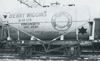 Berry Wiggins fleet number 120 meanwhile was the last of the company's five strong fleet of 14 ton petrol tank wagons numbered from 116 and built by G.R. Turner in 1942. 120 was registered with the London Midland and Scottish Railway as 162603 and, like the Peco model illustrated above, was painted silver with mostly red lettering although the words Kingsnorth Petroleum in the Berry Wiggins roundel were picked out in blue and the speed restriction star was black. The solebar was red with white lettering with black springs and brake gear. Note in this case the horizontal tie rod between the stanchions and twin saddles but the absence of any access ladders when pictured at Hoo in 1968.