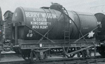 Berry Wiggins fleet number 68 was built by Charles Roberts in 1927 and registered as number 38398 by the London and North Eastern Railway. Most British based oil companies of the time operated similar tank wagons with a 14 ton capacity, many of which lasted into the 1960s. Fleet number 68 was photographed at Hoo Junction in 1968 and features steel wires wrapped around the cylindrical tank body to anchor it to its wooden cradle.